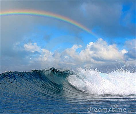 Ocean Wave In Tropical Paradise And Rainbow Stock Images